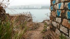 Moving through ruins to rocky sea shore, stony landscape and beach - stock footage
