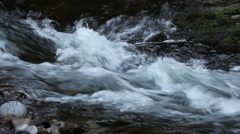 Gushing Water Flowing from Waterfall over Rocks and Boulders Movie 1920x1080 Stock Footage