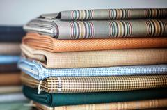 Folded fabrics in a neat stack Stock Photos