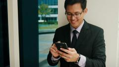 Businessman Writing With Pen On Mobile Phone Smartphone Stock Footage