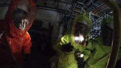 Firefighters with protective gear practice leak of Ammonia chemical Stock Footage