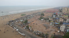 Crowds, traffic and beach apartments in Chennai Stock Footage