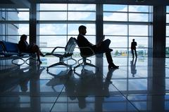 Reading in airport Stock Photos