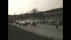 Vintage 16mm film, 1948, early stock car race, flagman starts Stock Footage