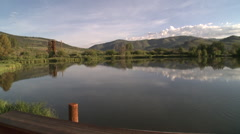 sunrise pond with reflection of mountain sky - stock footage
