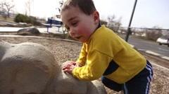 Playground boy climbing Stock Footage