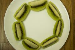 kiwi slice circle array - stock photo