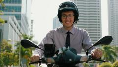 Chinese Businessman Commuter Using Scooter Motorcycle In City Stock Footage