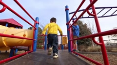Boy running on playground Stock Footage