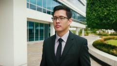 Chinese Businessman Commuter Walking To Office Building Stock Footage