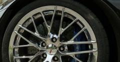 Zoom out from Corvette racing logotype on the body of a  aluminum wheel Stock Footage