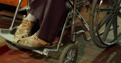 Legs Of Invalid In A Wheelchair 4k - stock footage