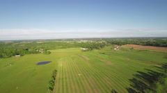 3555 Aerial Above Farmland in the Country, 4K - stock footage