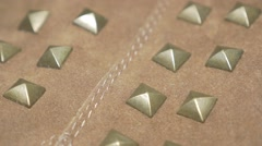 Leather fabric rivets on 4K 2160p UHD video - Golden rivets  panning 4K 3840X Stock Footage