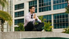 Chinese Businessman Meditating Yoga Outside Office During Work Break Stock Footage