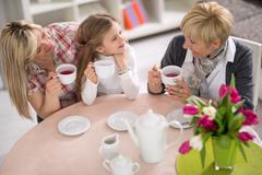 Stock Photo of Mother, grandmother and daughter together on tea party