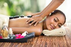 Stock Photo of Young attractive woman enjoying in Asian massage
