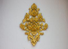 the art of handmade asian golden sculpture tracery - stock photo