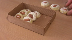 Packing of cookies in a box Stock Footage