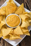 Nachos with Cheese Dip - stock photo