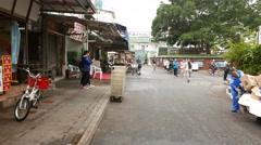 Walking into fisherman village, Lei Yue Mun. Habitants on the way Stock Footage