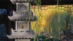 Traditional Asian Garden with Weeping Willows and Stone Pagoda in 4k - stock footage