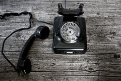 Black rotary telephone with the receiver off-hook Stock Photos
