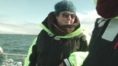 Young Woman Excited to be on Boat to Whale Watching ICELAND Stock Footage