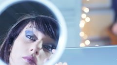 Beautiful woman doing make up reflection in the mirror Stock Footage