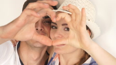 Couple make heart shape with hands Stock Footage