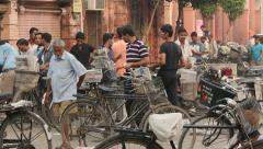 Workers sort newspapers in the early morning in Amritsar, India Stock Footage