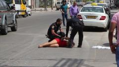 The police arrested woman. Ghetto in Israel - stock footage