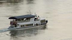 Pleasure boat floating on the river - stock footage