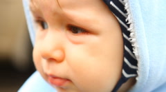 a little sad child looks around, close-up - stock footage