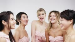 Beautiful bridesmaids throwing confetti slow motion wedding photo booth series - stock footage