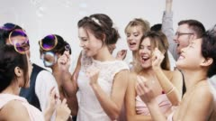 Bridesmaids dancing slow motion wedding photo booth series - stock footage
