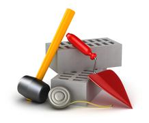 Building tools : hammer trowel and brick. Isolated on white. Stock Illustration
