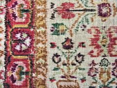 Old faded carpet with floral ornament closeup Stock Photos