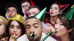 Multi-ethnic group of people celebrating birthday party slow motion photo booth - stock footage