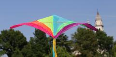 kite flies towards the religious building - stock photo