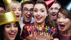 Woman blowing out candles birthday party slow motion photo booth - stock footage