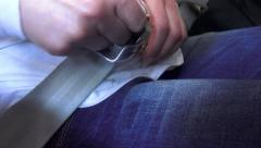 4K View of the woman unfastening her seat belt. Safe travel is of great impor Stock Footage