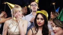 Mixed race group of friends celebrating independence day slow motion party photo - stock footage