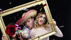 Crazy friends wearing Halloween costume slow motion party photo booth Stock Footage