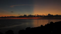 Scenic sunrise over the sea. Spectacular, fantastic sky and clouds. - stock footage