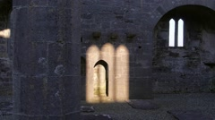 Stock Video Footage of Sunlight Falls on Ruined Abbey Walls