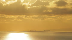 Two big ships is sailing on the sea. Scenic sunset, spectacular sky and clouds. - stock footage