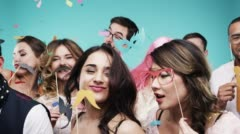 Multi racial group of funny people celebrating slow motion party photo booth Stock Footage