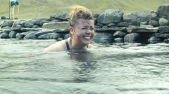 Tourists Laughing in a Hotspring in ICELAND  Stock Footage