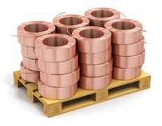 Stacked hunks of copper cable on shipping pallet Stock Photos